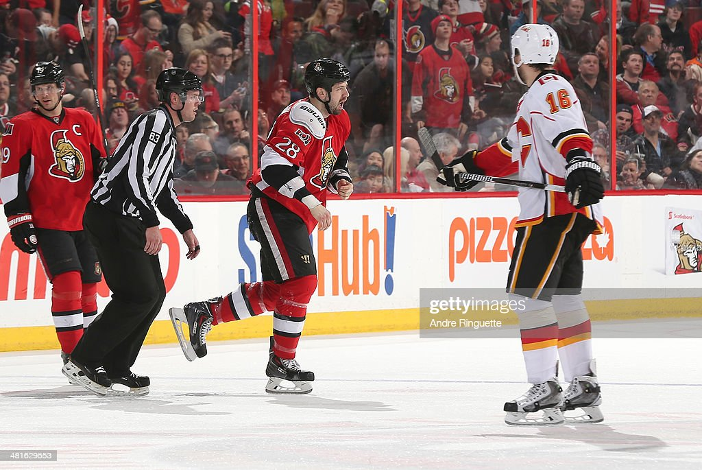 Matt Kassian #28 of the Ottawa Senators gets fired up after a first period fight as Brian McGrattan #16 of the Calgary Flames and teammate Jason Spezza #19 look on at Canadian Tire Centre on March 30, 2014 in Ottawa, Ontario, Canada.