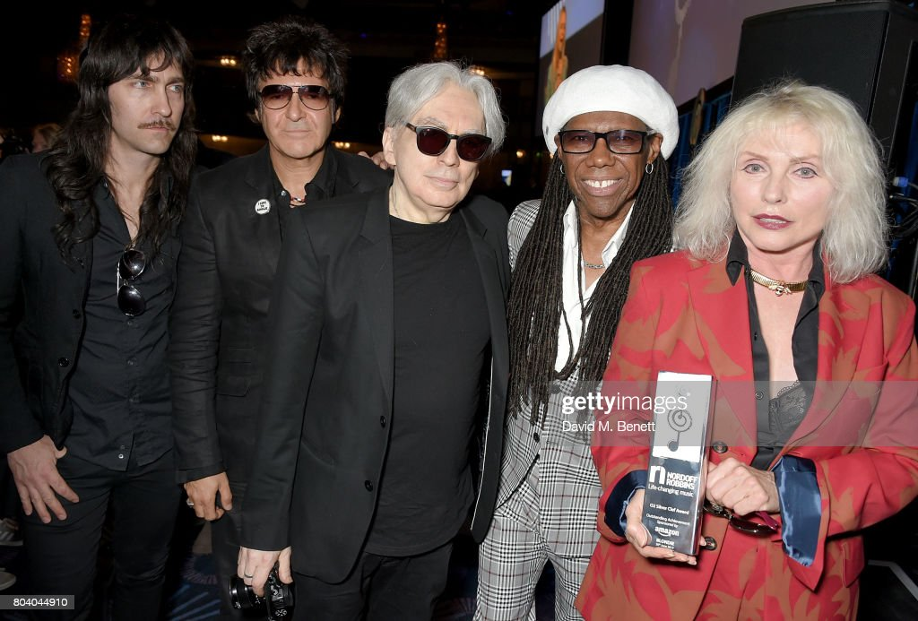 Matt Katz-Bohen, Clem Burke, Chris Stein, Nile Rodgers and Debbie Harry with Blondie's Amazon Outstanding Achievement Award at the Nordoff Robbins O2 Silver Clef Awards at The Grosvenor House Hotel on June 30, 2017 in London, England.