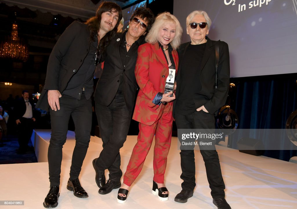Matt Katz-Bohen, Clem Burke, Debbie Harry and Chris Stein of Blondie with their Amazon Outstanding Achievement Award at the Nordoff Robbins O2 Silver Clef Awards at The Grosvenor House Hotel on June 30, 2017 in London, England.