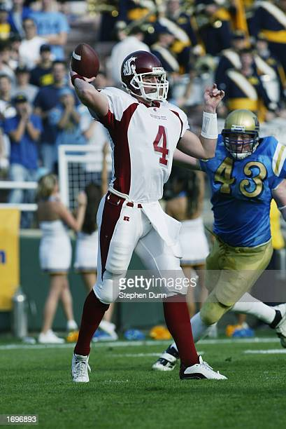 Matt Kegel of Washington State throws a pass during a game against UCLA on December 7 2002 at the Rose Bowl in Pasadena California Washington State...