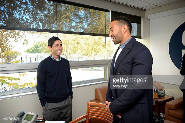 Matt Kemp AJ Preller of the San Diego Padres talk in Preller's office at Petco Park on December 19 2014 in San Diego California