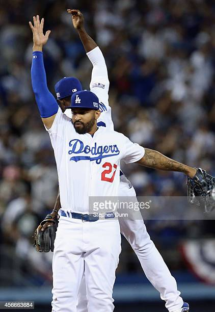 Matt Kemp and Dee Gordon of the Los Angeles Dodgers celebrate their team's 3-2 win over the St. Louis Cardinals in Game Two of the National League...