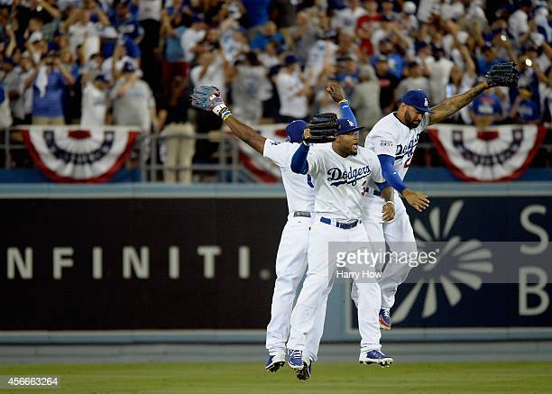 Matt Kemp Carl Crawford and Yasiel Puig of the Los Angeles Dodgers celebrates their team's 32 win over the St Louis Cardinals in Game Two of the...