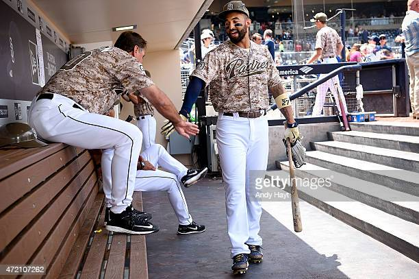 Matt Kemp greets Glenn Hoffman of the San Diego Padres in the dugout prior to the game against the Colorado Rockies at Petco Park on May 3 2015 in...