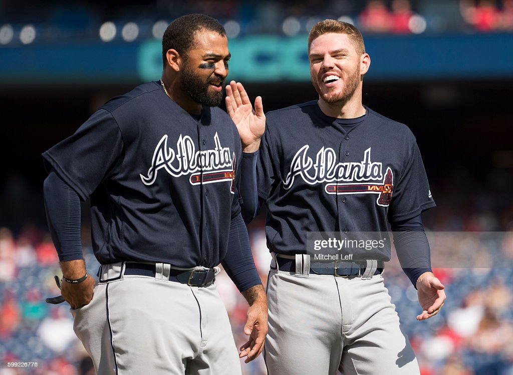 Matt Kemp #27 laughs with Freddie Freeman #5 of the Atlanta Braves after the top of the sixth inning against the Philadelphia Phillies at Citizens Bank Park on September 4, 2016 in Philadelphia, Pennsylvania. The Braves defeated the Phillies 2-0.