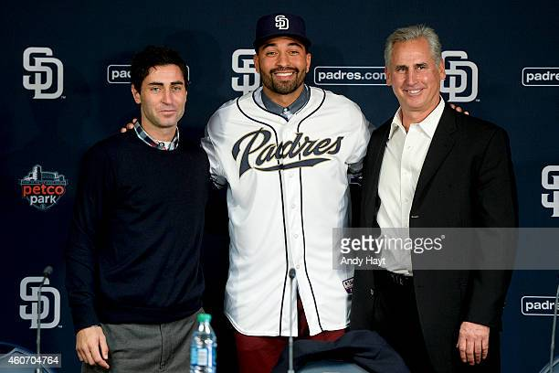 Matt Kemp Manager Bud Black and General Manager AJ Preller of the San Diego Padres at pose for a photo at a press conference introducing Kemp as the...