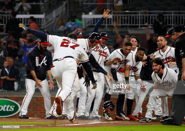Matt Kemp of the Atlanta Braves celebrates after hitting a walk-off two-run homer in the 11th inning for a 5-3 win over the San Francisco Giants at...