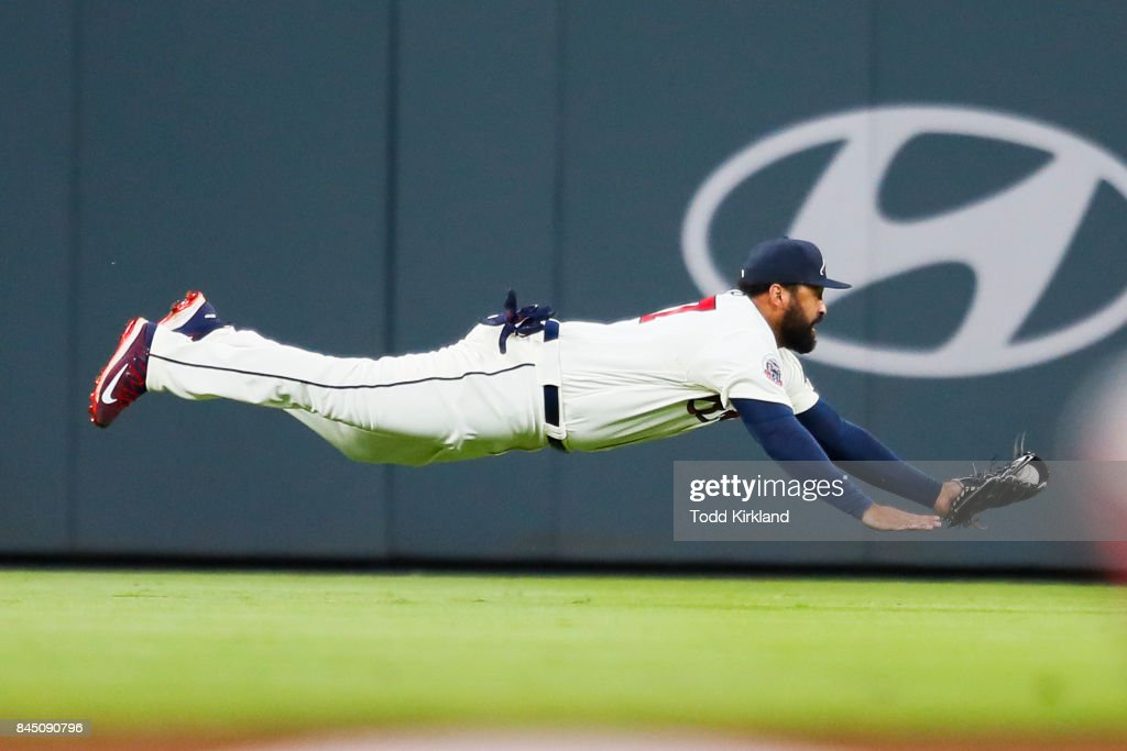 Matt Kemp #27 of the Atlanta Braves dives for the catch and throws to second for a double play in the seventh inning of an MLB game against the Miami Marlins at SunTrust Park on September 9, 2017 in Atlanta, Georgia. The Braves won 6-5.