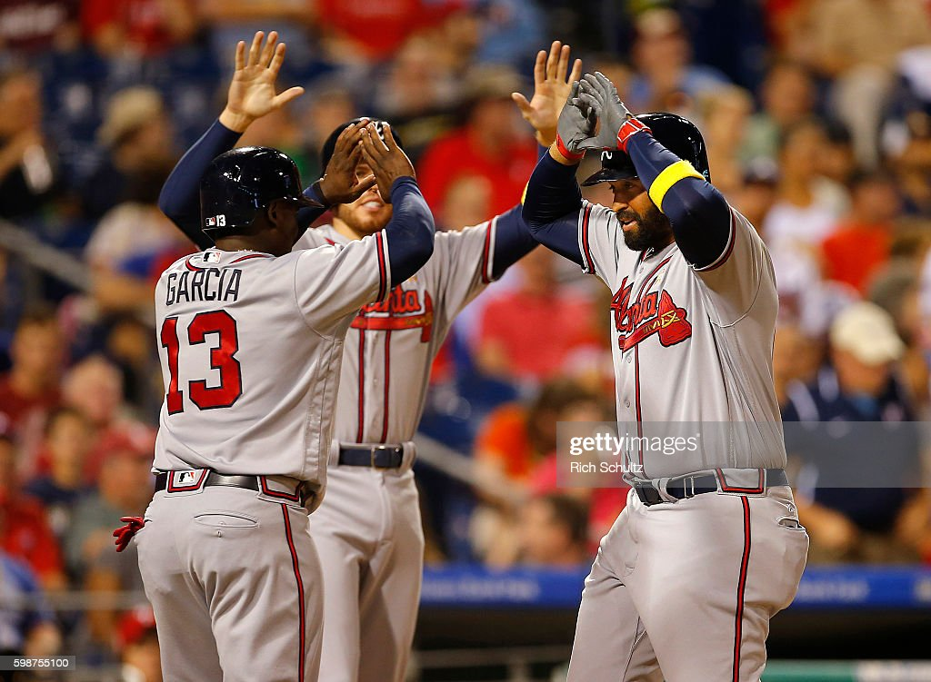 Matt Kemp #27 of the Atlanta Braves is congratulated by Adonis Garcia #13 and Freddie Freeman #5 after he hit a three run home run against the Philadelphia Phillies during the fifth inning of a game at Citizens Bank Park on September 2, 2016 in Philadelphia, Pennsylvania.