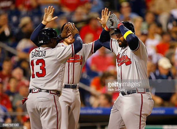 Matt Kemp of the Atlanta Braves is congratulated by Adonis Garcia and Freddie Freeman after he hit a three run home run against the Philadelphia...
