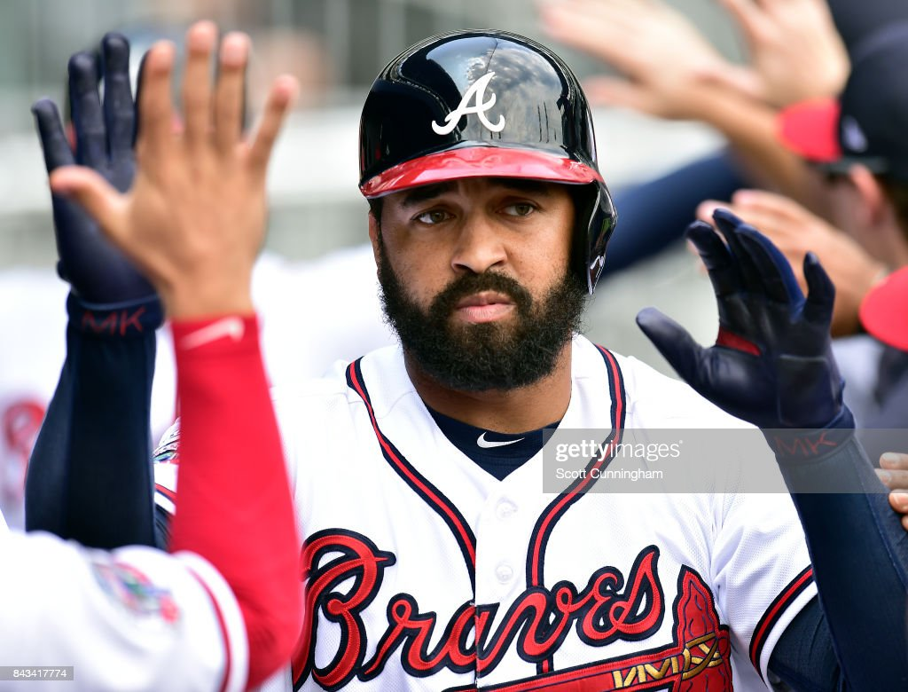 Matt Kemp #27 of the Atlanta Braves is congratulated by teammates after hitting a first inning two-run home run against the Texas Rangers at SunTrust Park on September 6, 2017 in Atlanta, Georgia.