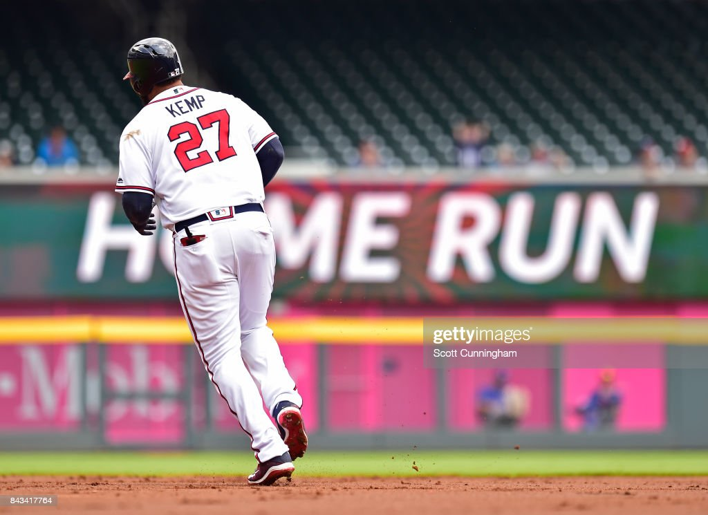Matt Kemp #27 of the Atlanta Braves rounds the bases after hitting a first inning two-run home run against the Texas Rangers at SunTrust Park on September 6, 2017 in Atlanta, Georgia.