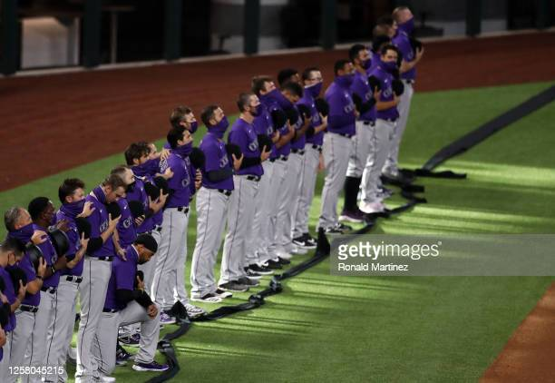 Matt Kemp of the Colorado Rockies takes a knee during the national anthem before a game against the Texas Rangers on Opening Day at Globe Life Field...