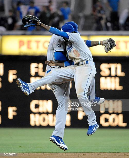 Matt Kemp of the Los Angeles Dodgers and Dee Gordon celebrate after getting the final during a baseball game against the San Diego Padres at Petco...