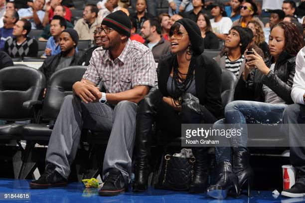 Matt Kemp of the Los Angeles Dodgers and RB singer LeToya Luckett watch a game between the Golden State Warriors and the Los Angeles Clippers at...