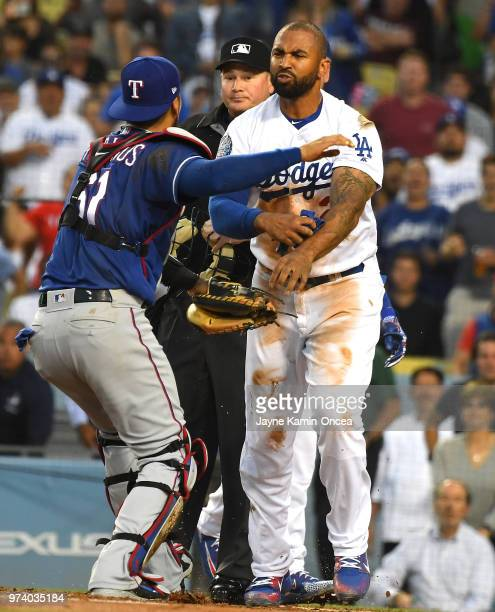 Matt Kemp of the Los Angeles Dodgers and Robinson Chirinos of the Texas Rangers exchange words as tempers flared after a collision at home plate in...