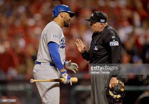 Matt Kemp of the Los Angeles Dodgers argues with home plate umpire Dale Scott after getting called out in the ninth inning against the St Louis...