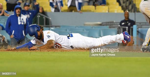Matt Kemp of the Los Angeles Dodgers beats the throw to Jonathan Lucroy of the Oakland Athletics as he scores on a sacrifice fly by Chase Utley of...