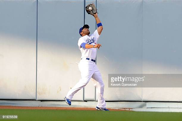 Matt Kemp of the Los Angeles Dodgers catches a ball in the outfield hit by Chase Utley of the Philadelphia Phillies for the second out in the first...
