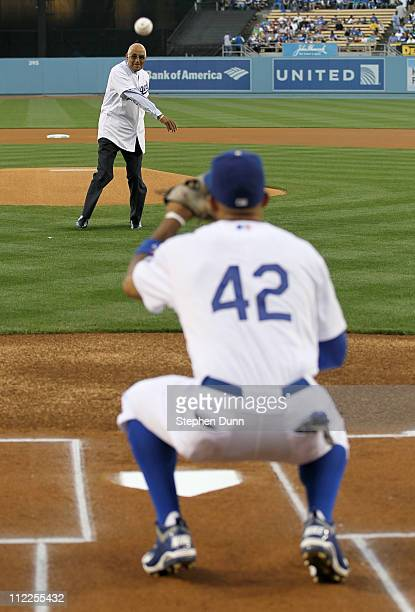 Matt Kemp of the Los Angeles Dodgers catches the ceremonial first pitch thrown by Don Newcombe former Brooklyn Dodgers teammate of Jackie Robinson...