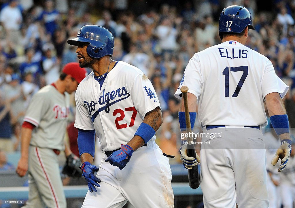 Matt Kemp #27 of the Los Angeles Dodgers celebrates after scoring in the first inning against the Philadelphia Phillies at Dodger Stadium on June 27, 2013 in Los Angeles, California.