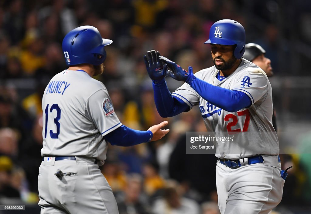 Matt Kemp #27 of the Los Angeles Dodgers celebrates his three run home run with Max Muncy #13 during the fifth inning against the Pittsburgh Pirates at PNC Park on June 6, 2018 in Pittsburgh, Pennsylvania.
