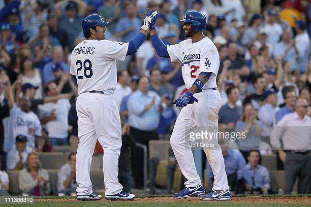Matt Kemp of the Los Angeles Dodgers celebrates with Rod Barajas after scoring on a past ball in the sixth inning against the San Francisco Giants on...