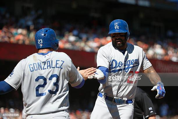 Matt Kemp of the Los Angeles Dodgers celebrates with teammate Adrian Gonzalez after hitting a tworun home run during the sixth inning against the San...