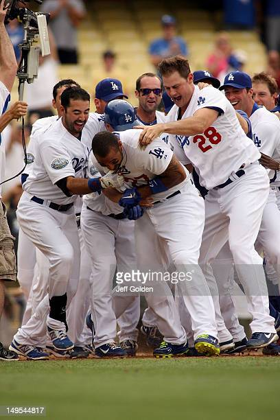 Matt Kemp of the Los Angeles Dodgers celebrates with teammates Andre Ethier Matt Treanor Adam Kennedy and winning pitcher Jamey Wright after he hit a...