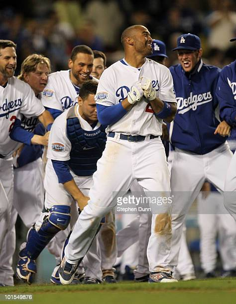 Matt Kemp of the Los Angeles Dodgers celebrates with teammates at home plate after hitting a walk off home run in the tenth inning against the...