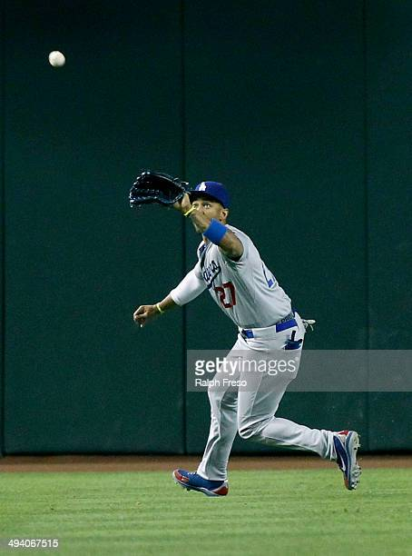 Matt Kemp of the Los Angeles Dodgers chases down a fly ball against the Arizona Diamondbacks during the seventh inning of a MLB game at Chase Field...