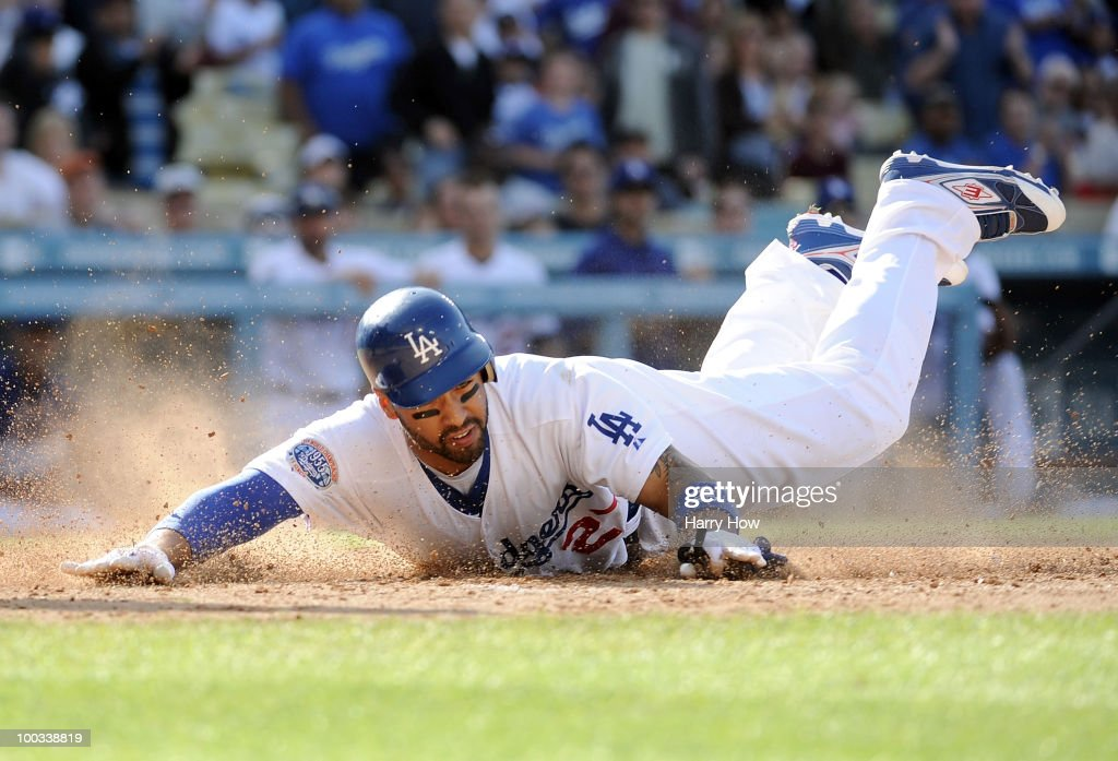 Matt Kemp #27 of the Los Angeles Dodgers dives home to score a run against the Detroit Tigers during the fourth inning at Dodger Stadium on May 22, 2010 in Los Angeles, California.