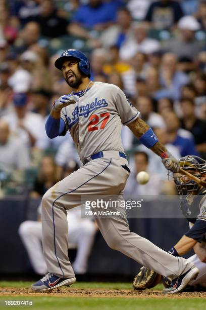 Matt Kemp of the Los Angeles Dodgers fouls a pitch off his foot in the top of the third inning against the Milwaukee Brewers at Miller Park on May 21...