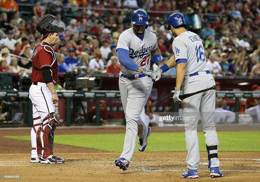 Matt Kemp #27 of the Los Angeles Dodgers high-fives Andre Ethier #16 after Kemp hit a solo home run against the Arizona Diamondbacks during the second inning of the MLB game at Chase Field on April 13, 2014 in Phoenix, Arizona.