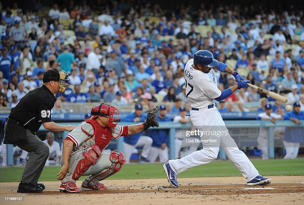 Matt Kemp #27 of the Los Angeles Dodgers hits a RBI double in the first inning against the Philadelphia Phillies at Dodger Stadium on June 27, 2013 in Los Angeles, California.