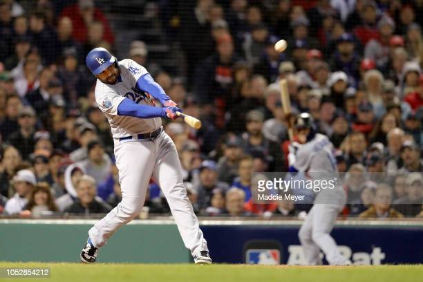 Matt Kemp of the Los Angeles Dodgers hits a second inning home run against the Boston Red Sox in Game One of the 2018 World Series at Fenway Park on...