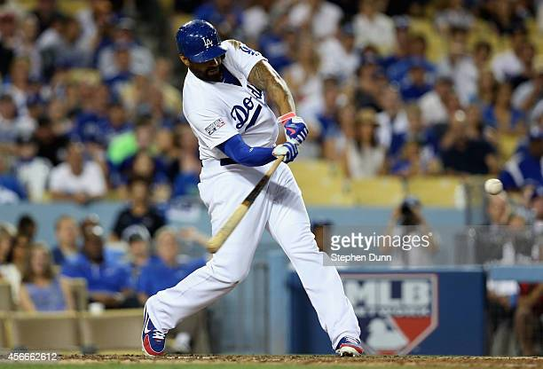 Matt Kemp of the Los Angeles Dodgers hits a solo homerun to lead off in the eighth inning of Game Two of the National League Division Series against...
