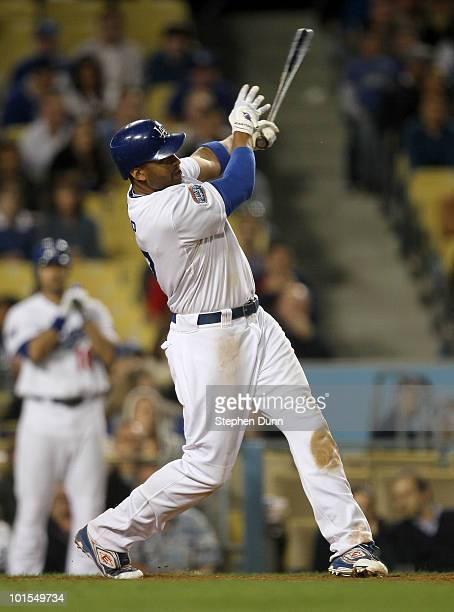 Matt Kemp of the Los Angeles Dodgers hits a walk off home run in the tenth inning against the Arizona Diamondbacks on June 1 2010 at Dodger Stadium...