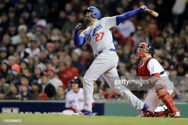 Matt Kemp of the Los Angeles Dodgers hits an RBI sacrifice fly during the fourth inning against the Boston Red Sox in Game Two of the 2018 World...