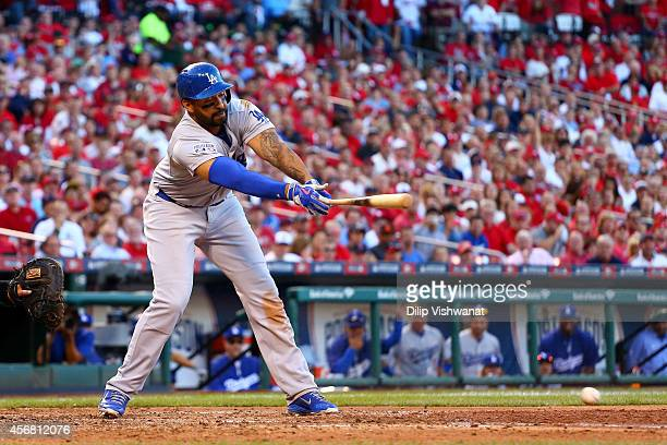 Matt Kemp of the Los Angeles Dodgers hits into an RBI double play in the sixth inning against the St Louis Cardinals in Game Four of the National...