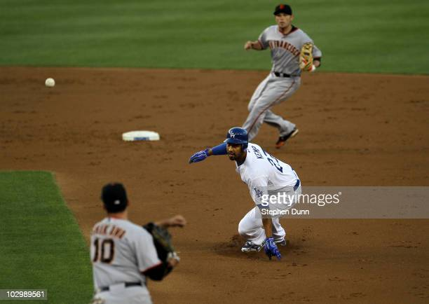 Matt Kemp of the Los Angeles Dodgers is caught in a rundown between first baseman Travis Ishikawa and second baseman Freddy Sanchez of the San...