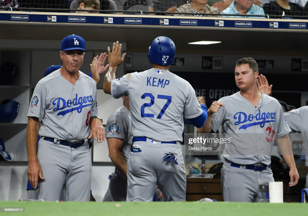 Matt Kemp #27 of the Los Angeles Dodgers is congratulated after scoring during the third inning of a baseball game against the San Diego Padres at PETCO Park on July 11, 2018 in San Diego, California.