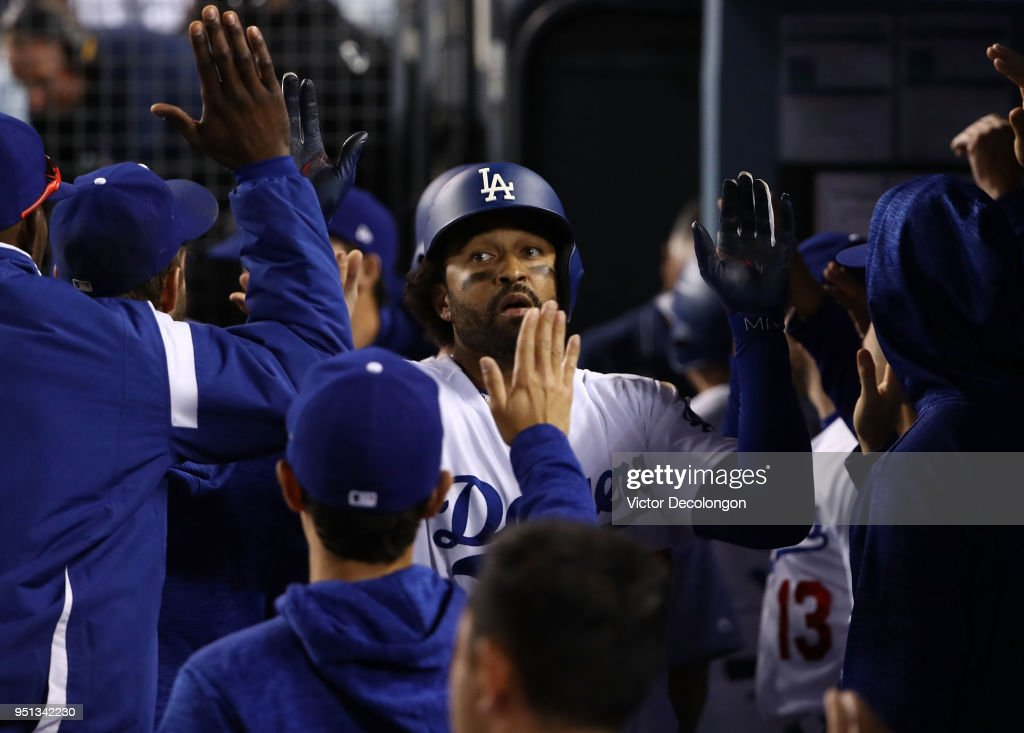 Matt Kemp #27 of the Los Angeles Dodgers is congratulated by teammates after hitting a two-run homerun in the eighth inning during the MLB game against the Miami Marlins at Dodger Stadium on April 25, 2018 in Los Angeles, California. The Marlins defeated the Dodgers 8-6.