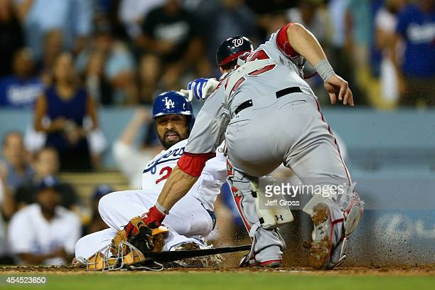 Matt Kemp of the Los Angeles Dodgers is tagged out at home by catcher Wilson Ramos of the Washington Nationals in the fourth inning at Dodger Stadium...