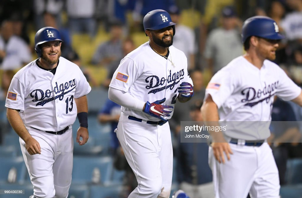 Matt Kemp #27 of the Los Angeles Dodgers, Logan Forsythe #11 and Max Muncy #13 are all smiles after Kemp hit a three run home run against the Pittsburgh Pirates in the sixth inning at Dodger Stadium on July 2, 2018 in Los Angeles, California.