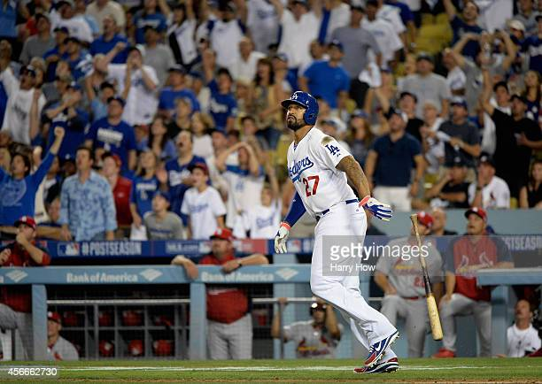 Matt Kemp of the Los Angeles Dodgers reacts after hitting a solo homerun to lead off and take a 32 lead in the eighth inning of Game Two of the...