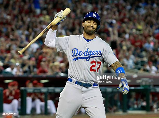 Matt Kemp of the Los Angeles Dodgers reacts after lining out for the third out with the bases loaded against the Arizona Diamondbacks during the...