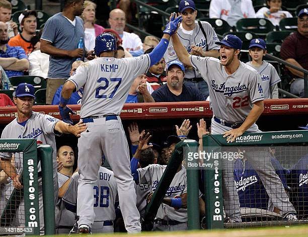 Matt Kemp of the Los Angeles Dodgers receives a high five from Clayton Kershaw after hitting a tworun home run in the first inning against the...