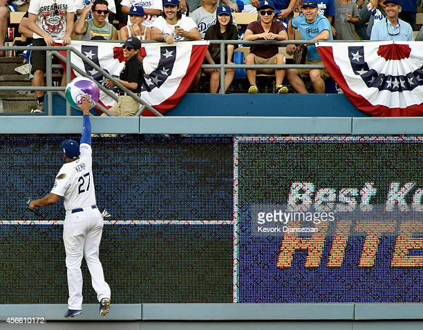Matt Kemp of the Los Angeles Dodgers returns a beach ball in the sixth inning of Game One of the National League Division Series against the St Louis...