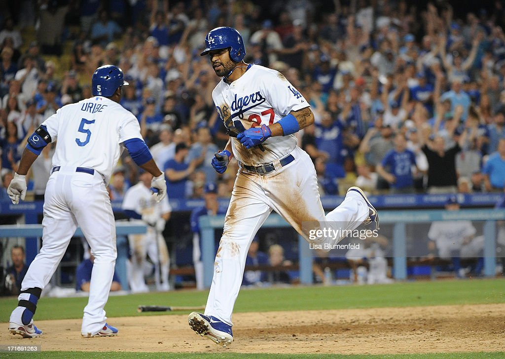Matt Kemp #27 of the Los Angeles Dodgers scores in the eighth inning against the Philadelphia Phillies at Dodger Stadium on June 27, 2013 in Los Angeles, California.